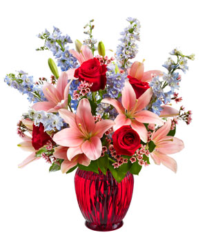 Bouquet with roses, lilies, delphinium, and waxflower