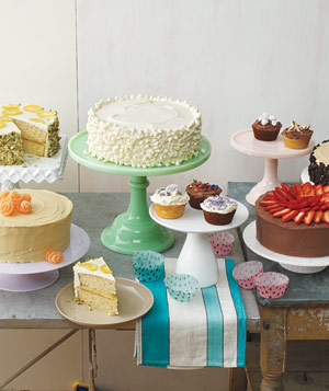 Table spread of various cakes