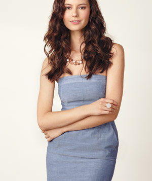 Model wearing strapless Old Navy denimlike weave dress, white ring and beaded necklace