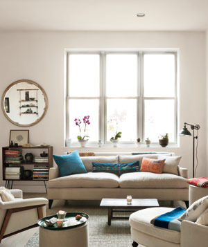 Living room with light-toned furniture, floors and walls