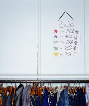 Clothes rack with sale sign
