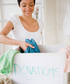 Woman putting clothing in donation box