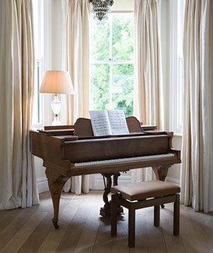 Piano by a window