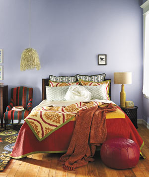 Exotic escape lavender bedroom with bright textiles