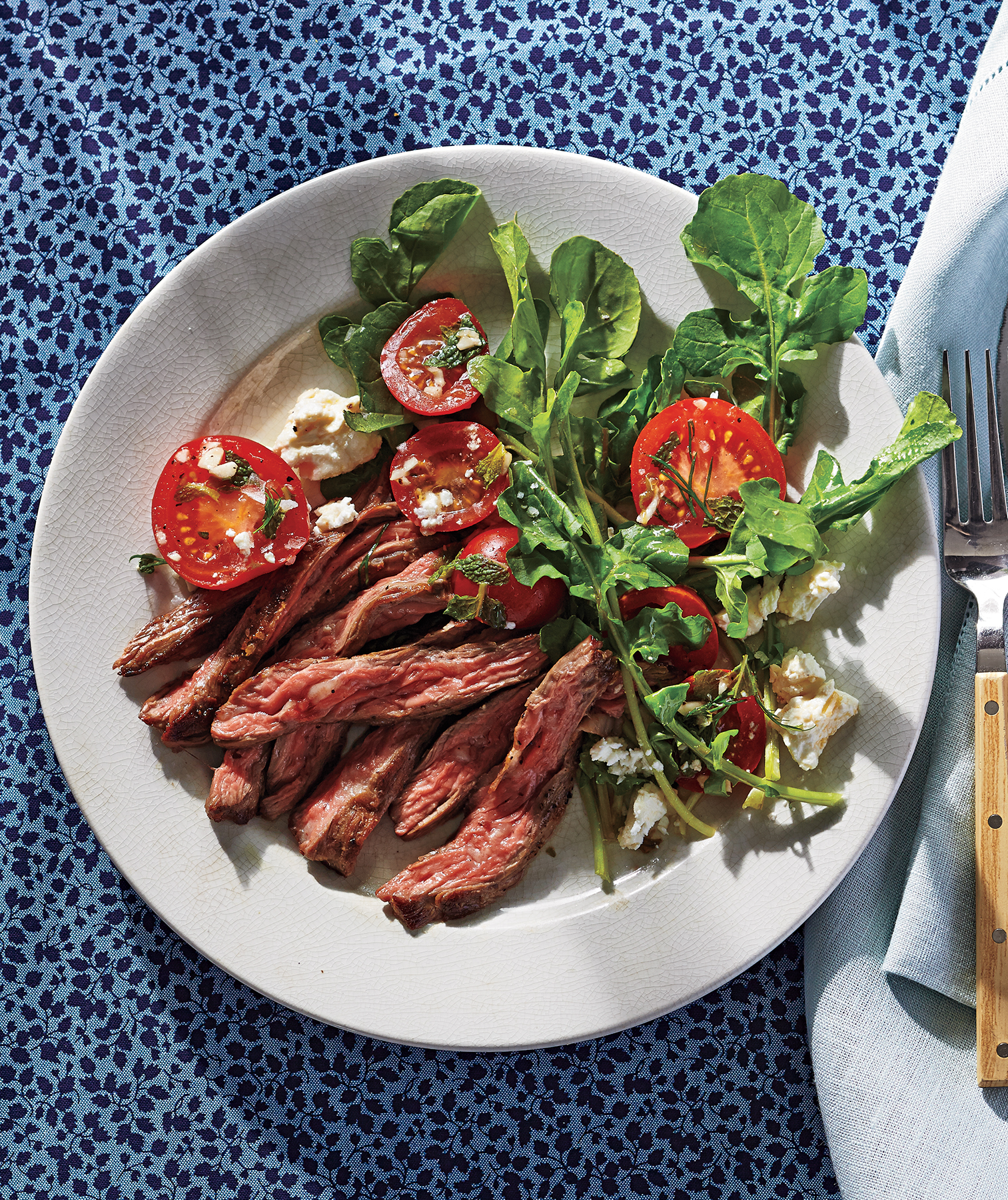 Skirt Steak With Tomato, Feta, and Herbs