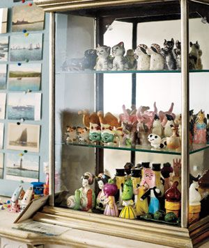 Salt snd pepper shaker collection in a curio cabinet
