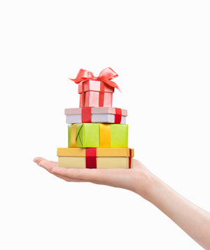 Hand holding small gift boxes
