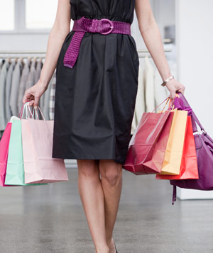 Woman holding shopping bags from a shopping spree