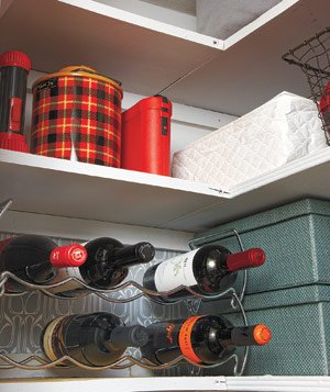 Closet shelf with wine rack and containers