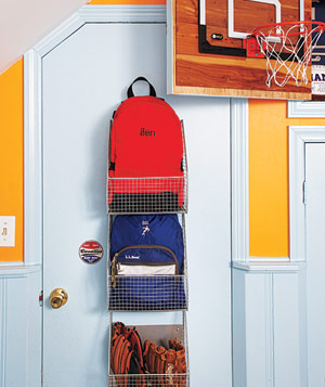 Bedroom door with hanging wire basket organizers and a SKLZ basketball hoop