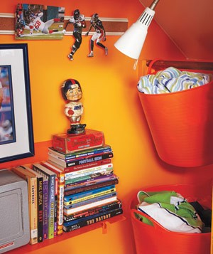 Orange closet with books on Piegato One shelf and hanging TubTrugs baskets