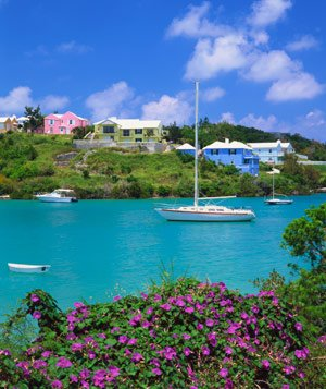 Boats floating in inlet with houses in the background in Bermuda