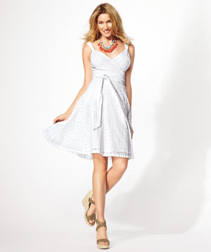 Model wearing American Living for JCPenney eyelet dress, brown leather sandals and beaded necklace
