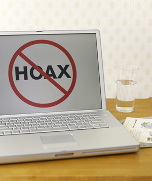 Laptop computer with HOAX sign on screen