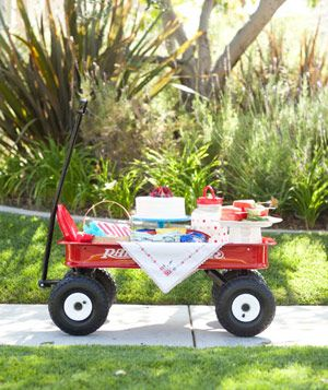 Red wagon containing full picnic spread - Landscape