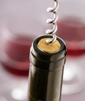 Bottle of red wine with cork and corkscrew