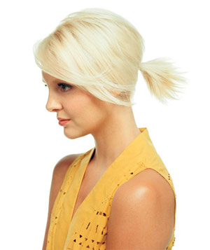 Model with short blonde hair in a ponytail