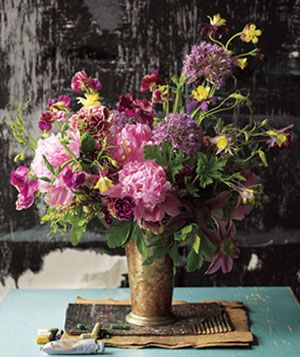 Mixed bouquet  in mental vase with geranium, peonies, carnations, sweat pea, columbine and clematis flowers