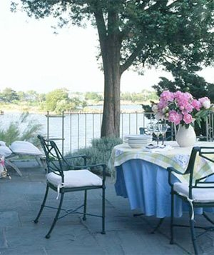 Blue flagstone terrace with wrought iron table and chairs