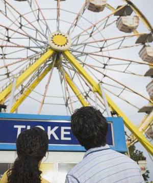 Couple watching a Ferris wheel