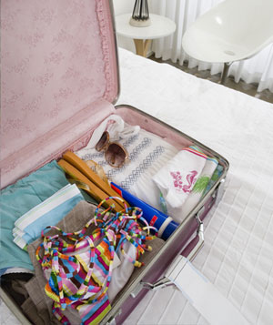 Packed suitcase on a bed
