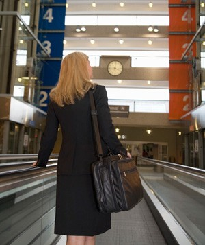 Woman on moving walkway in airport
