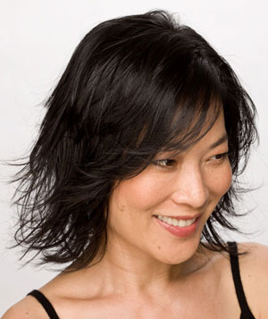 Black-haired model with layered bob hairstyle from the side