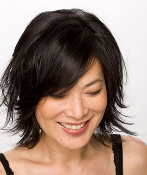 Smiling model with black layered bob hairstyle