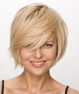 Smiling blonde model with short textured bob haircut