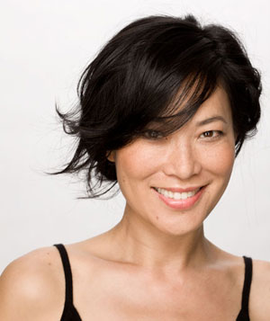 Smiling model with short black wispy haircut