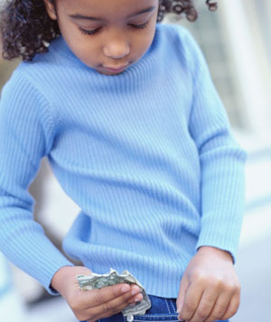 Girl pulling money out of jean pocket