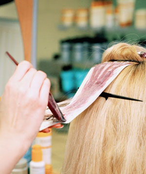 Blonde woman getting foils at a hair salon