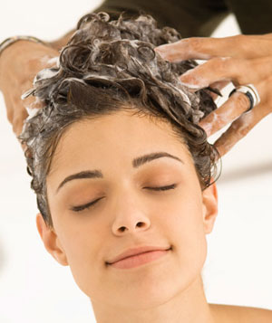 Woman having hair washed by a hairdresser