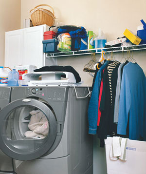 Cluttered laundry room