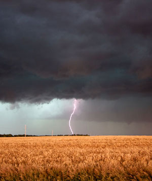 Lightening striking in a field