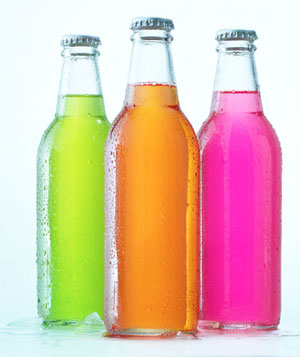 Cold glass bottles of colored soda