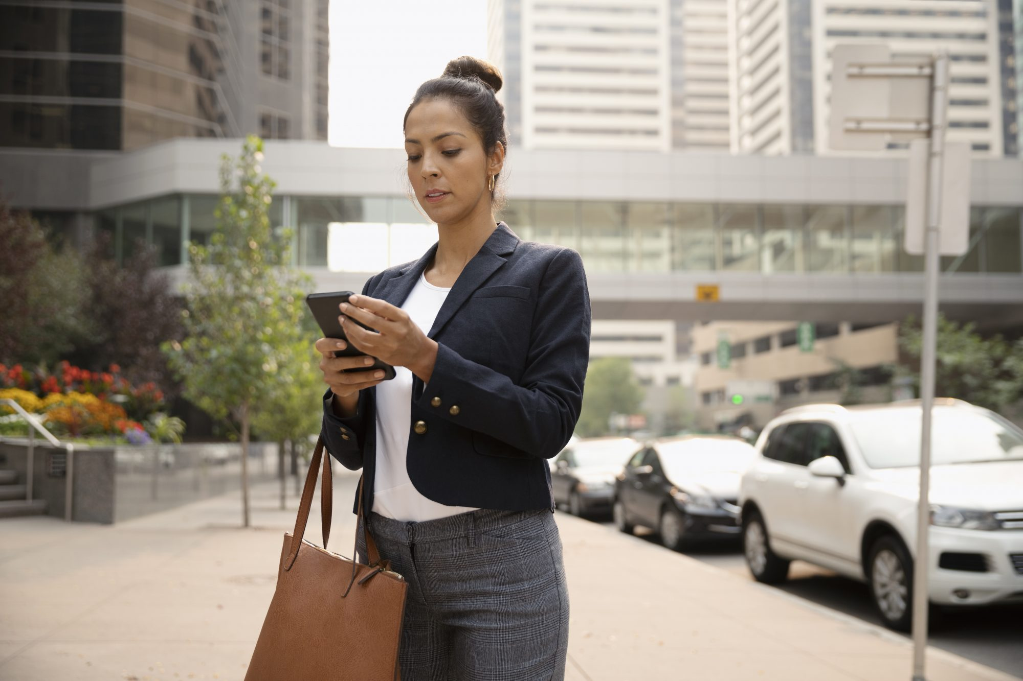 Business woman on her phone outside