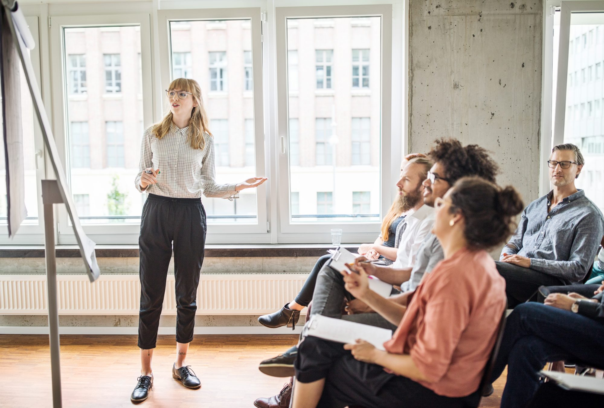 women presenting to staff at work