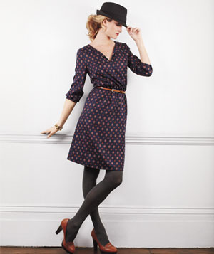 Model wearing blue patterned long-sleeved dress, grey tights, platform loafers and Michael Stars hat