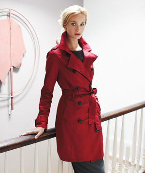 Model wearing red trench coat with wiide collar