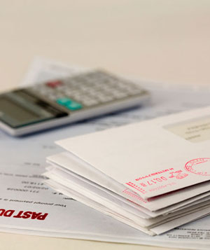 A stack of bills and a calculator