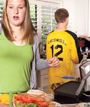 Family preparing sandwiches together
