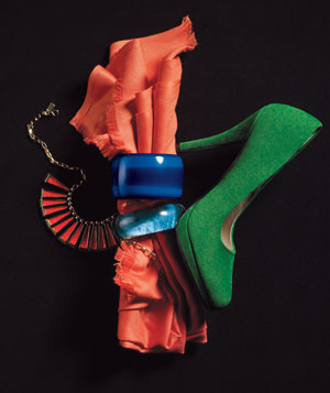 Green suede shoe, orange scarf, chunky blue resin bangles, red necklace