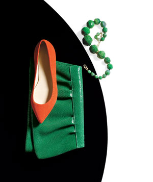 Orange suede shoe, green snake-skin clutch and chunky green necklace