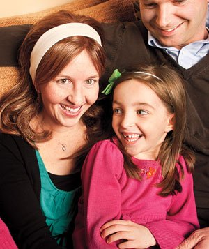 Breast cancer survivor and her family smiling