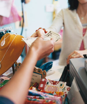 Woman paying cashier in boutique