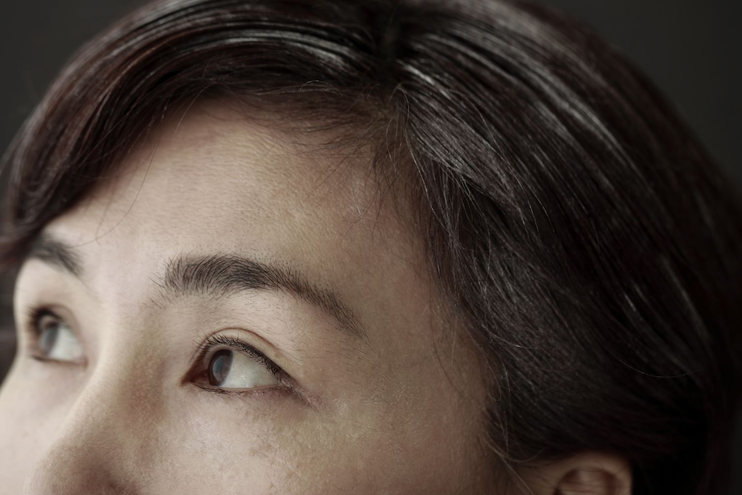 woman with a couple gray hairs