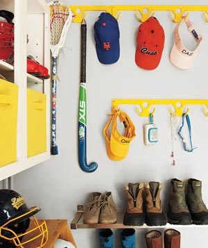 Entry room with wall hooks and shoe shelves