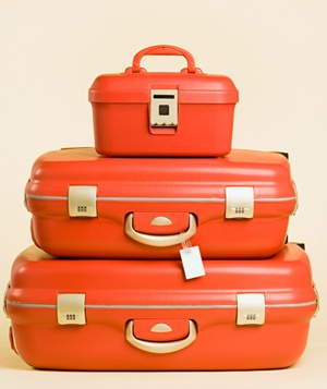 Stack of orange suitcases