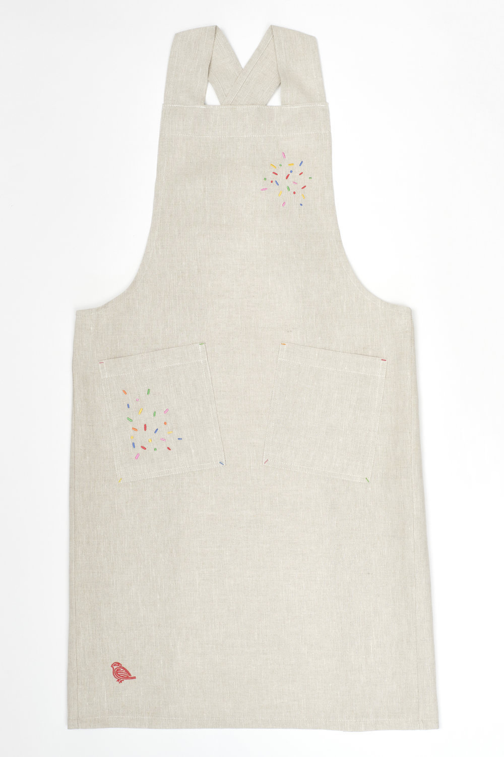 linen apron with embroidered sprinkles detailing